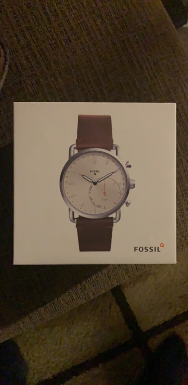 round silver analog watch with brown leather strap