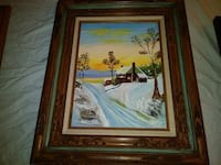 house with snow painting with brown wooden frame