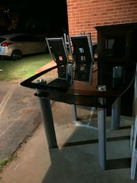 glass table with 4 chairs  Statesville, 28677