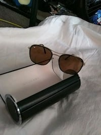 black sunglasses with black frames. They where a g San Leandro, 94577