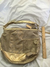 Gold-colored and beige Coach monogram hobo bag; brown wooden ruler Milton, 02186