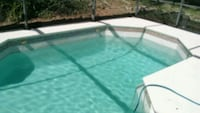 green and white in-ground pool