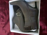 pair of black leather boots in box Durham