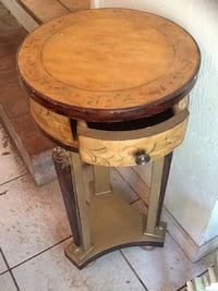 Round brown wooden single drawer side table