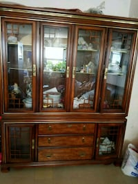 brown wooden framed glass display cabinet Brooklyn, 11209