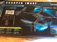 black and yellow Sharper Image streaming drone box