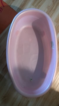 Baby's pink and blue plastic bather  Woodstock, 21163