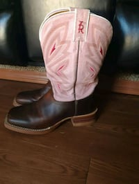 pair of pink-and-black leather square-toe cowboy boots Pell City