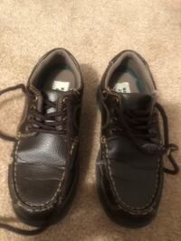 pair of black leather shoes 103 mi