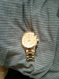 round gold-colored chronograph watch with link bra Surrey, V3V 3N6