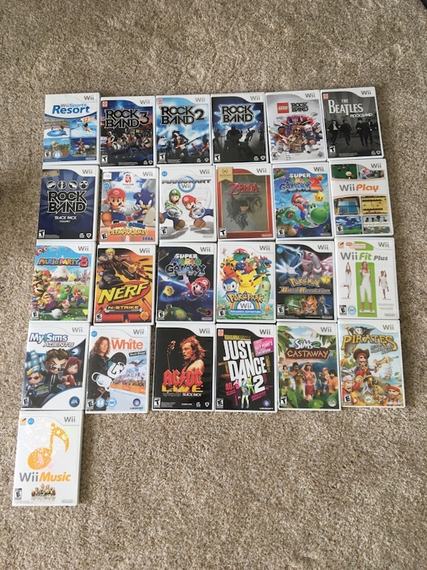 Wii System With Rockband Set and 25 Games d412ee7f-8ee9-4857-887d-c6d3c27dd65c