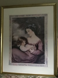 Woman in dark pink dress painting with golden frame