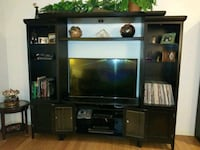 flat screen television with brown wooden TV hutch Seminole, 33772