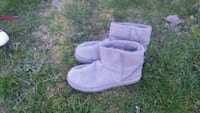 pair of white suede mid-calf boots