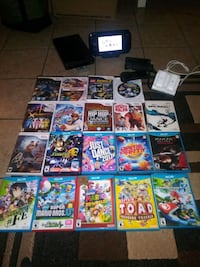 WII U AMD 29 GAMES AND 3 CONTROLLERS LIKE NEW ALL FOR $200.00