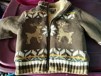 brown and white Christmas-themed sweater