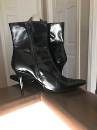 Pair of black leather heeled boots Calgary, T2N