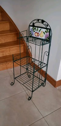 Beautiful Metal Shelving Unit with Ceramic Décor Plate.