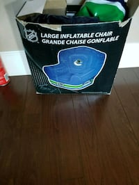 blue and black inflatable Canucks chair