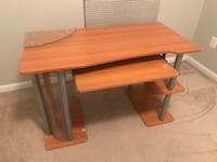 brown wooden computer desk with gray metal base Baltimore, 21202