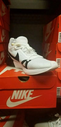 pair of white Nike running shoes with box West New York, 07093