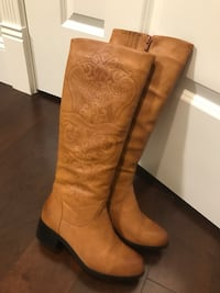 Pair of brown leather knee-high boots Richmond, V6X 1A7
