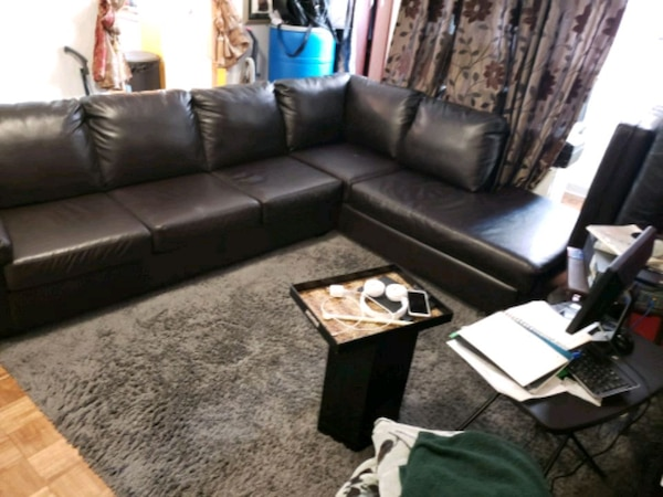 brown leather sectional sofa with throw pillows