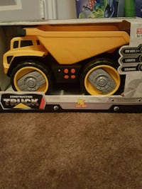 Yellow toy dump truck for kids.