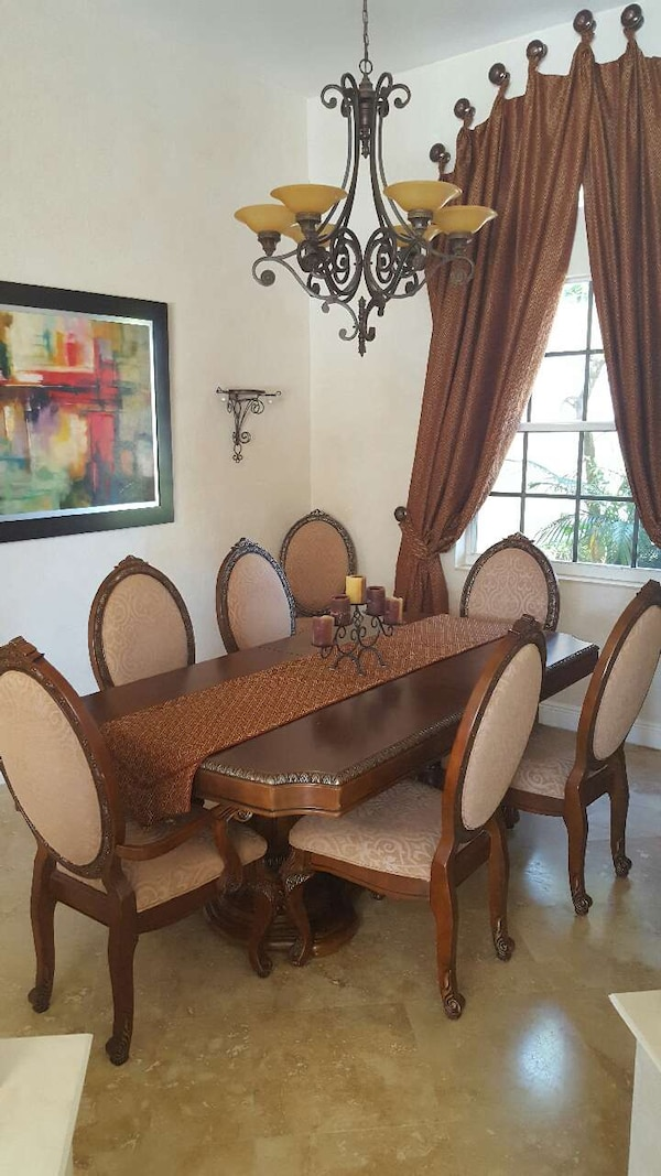 Beautiful wood dining room table with 8 chairs