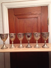 several silver-colored footed drinking glasses