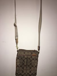 MIchael Kors cross body, worn on the back, front is good condition  Vaughan, L4L 1A6