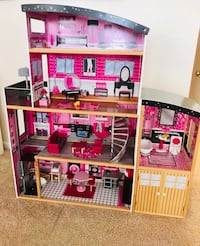 pink and white doll house