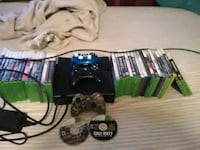 black Xbox 360 console with controller and game cases Brumley, 65017