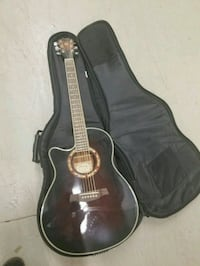 Left handed acoustic electric guitar