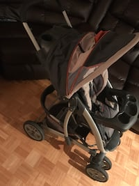 baby's gray and black graco stroller