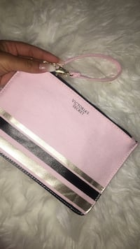 white and pink Michael Kors leather wristlet Kitchener