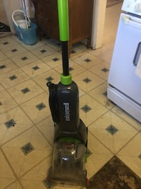 Black bissell upright vacuum cleaner 2049 mi