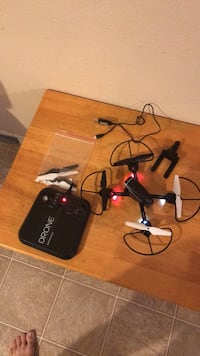 Black and red quadcopter drone with remote. There's nothing wrong with it just don't play with it anymore and batteries included. El Paso, 79936