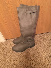 pair of gray knee high boots