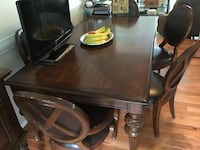 Rectangular brown wooden table with Six chairs dining set. 2 aArm and 4 Side Chairs including Buffet. All has normal wear but very solid  buffet need some repair but very solid. Table also Includes the additional center add on. Woodbridge, 22191