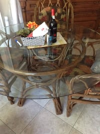 Palma Brava 6 chairs with matching glass top table Russell, K4R 0A1