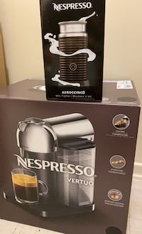 Brand new Nespresso machine and milk