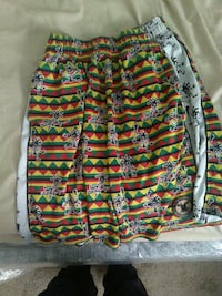 black, yellow, red, and green tribal print shorts