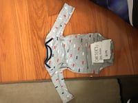 baby's white and black onesie Mississauga, L5V 2W7
