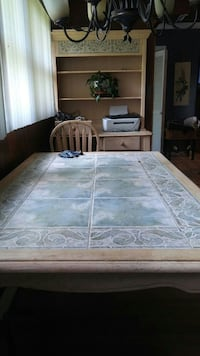 China cabinet with a dining room table no chairs