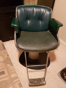 Black and green leather rolling barber chair