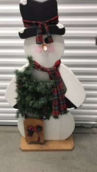 Four and a half ft tall wooden snowman in excellent condition, very sturdy. Always used on a covered porch. Milford, 45150
