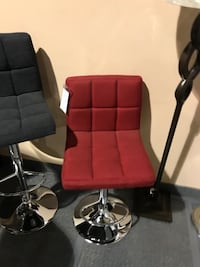 two red leather padded bar stools Toronto, M3H 5R9