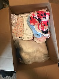 The box of NB and 3m baby girl clothes