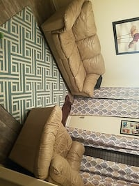 2 tan leather couches.